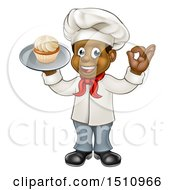 Full Length Happy Black Male Chef Baker Gesturing Ok And Holding A Cupcake On A Tray