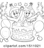 Black And White Boy And Girl Celebrating At A Birthday Party With A Cake