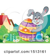 Happy Bunny Rabbit Hugging A Giant Easter Egg