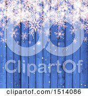 Blue Winter Or Christmas Background With Snowflakes Over Wood