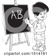Boy Writing The Alphabet On A Black Board