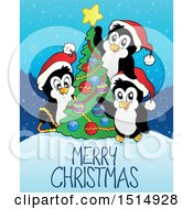Merry Christmas Greeting With Penguins Decorating A Tree