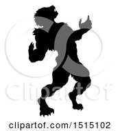 Clipart Of A Black Silhouetted Werewolf Beast Howling And Transforming Royalty Free Vector Illustration