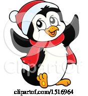 Christmas Penguin Wearing A Scarf And Santa Hat