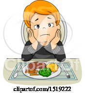 Boy Sitting With No Appetite In Front Of His Dinner