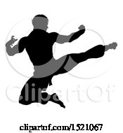 Clipart Of A Silhouetted Martial Artist Kicking Royalty Free Vector Illustration by AtStockIllustration