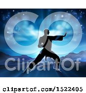 Clipart Of A Silhouetted Man In A Karate Pose Against A Sunrise Royalty Free Vector Illustration by AtStockIllustration