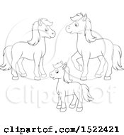 Clipart Of A Black And White Horse Family Royalty Free Vector Illustration