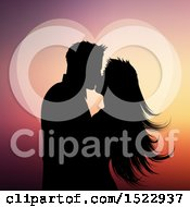 Clipart Of A Silhouetted Valentines Day Couple Kissing Against A Heart Royalty Free Vector Illustration by KJ Pargeter