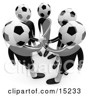 Team Of Soccer Players With A Soccer Ball Heads Putting Their Hands Together During A Huddle