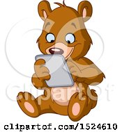 Clipart Of A Cartoon Happy Teddy Bear Using A Tablet Royalty Free Vector Illustration by yayayoyo