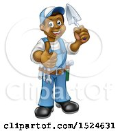 Full Length Black Male Mason Worker Holding A Trowel And Giving A Thumb Up