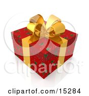 Christmas Gift Present Wrapped In Red Christmas Tree Patterned Wrapping Paper And A Gold Ribbon And Bow