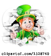 Clipart Of A St Patricks Day Leprechaun Giving Two Thumbs Up And Breaking Through White Brick Wall Royalty Free Vector Illustration by AtStockIllustration