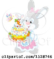 Female Rabbit Holding An Easter Cake