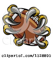 Clipart Of Eagle Claws Grasphing An American Football Royalty Free Vector Illustration by AtStockIllustration