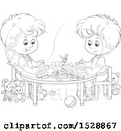 Black And White Boy And Girl With Blocks And Toys At A Table