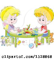 Caucasian Boy And Girl With Blocks And Toys At A Table