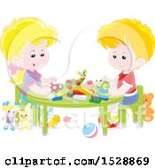 White Boy And Girl With Blocks And Toys At A Table
