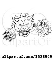 Clipart Of A Black And White Wolf Mascot Holding A Video Game Controller And Breaking Through A Wall Royalty Free Vector Illustration