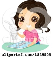 Clipart Of A Happy Girl Holding A 3d Printed Rabbit Toy Over A Tablet Royalty Free Vector Illustration