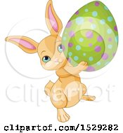 Clipart Of A Cute Beige Easter Bunny Rabbit Carrying An Egg Royalty Free Vector Illustration