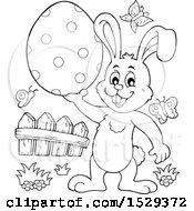 Black And White Bunny Rabbit Holding An Easter Egg