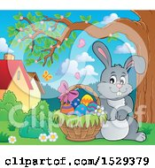 Clipart Of A Gray Bunny Rabbit With An Easter Basket Royalty Free Vector Illustration