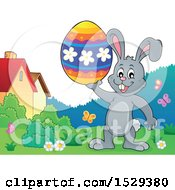 Clipart Of A Gray Bunny Rabbit Holding An Easter Egg Royalty Free Vector Illustration