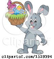 Clipart Of A Gray Bunny Rabbit Holding An Easter Basket Royalty Free Vector Illustration by visekart