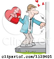 Caucasian Man Ringing A Doorbell And Holding A Valentines Day Box Of Candy