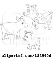 Clipart Of A Black And White Pig Family Royalty Free Vector Illustration