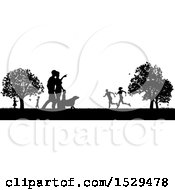 Clipart Of A Black And White Silhouetted Park With A Dog And People Grassy Field And Trees Royalty Free Vector Illustration
