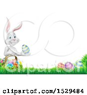 Border Of A White Easter Bunny Rabbit Holding An Egg By A Basket In The Grass