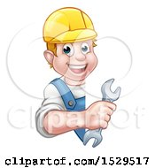 Happy White Male Worker Holding A Spanner Wrench Around A Sign