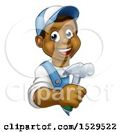Happy Black Male Carpenter Holding A Hammer Around A Sign