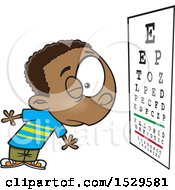 Clipart Of A Cartoon Boy Reading An Eye Chart During An Exam Royalty Free Vector Illustration