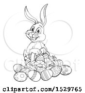 Black And White Bunny Rabbit With A Basket Of Easter Eggs And Flowers