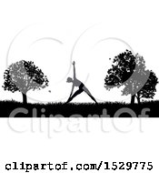 Clipart Of A Black And White Silhouetted Woman In A Pilates Pose In A Park Royalty Free Vector Illustration