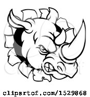 Black And White Tough Rhinoceros Sports Mascot Head Breaking Through A Wall