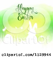 Clipart Of A Happy Easter Greeting With A Silhouetted Bunny Rabbit And Eggs Against Green Watercolor Royalty Free Vector Illustration