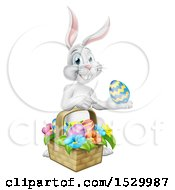 Happy White Easter Bunny Rabbit With A Basket And Eggs