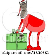 Clipart Of A Black Male Christmas Elf Picking Up A Gift Royalty Free Vector Illustration