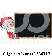 Christmas Santa Claus Looking Around A Blackboard