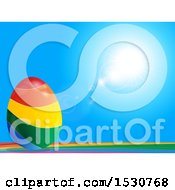 Clipart Of A 3d Rainbow Striped Easter Egg Against A Blue Sky Royalty Free Vector Illustration