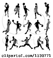 Clipart Of Silhouetted Basketball Players Royalty Free Vector Illustration by AtStockIllustration
