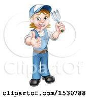 Full Length Happy White Female Gardener Holding A Garden Fork And Thumb Up