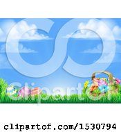 Background Of A Basket And Easter Eggs With Flowers In Grass