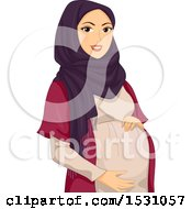 Pregnant Muslim Woman Holding Her Belly