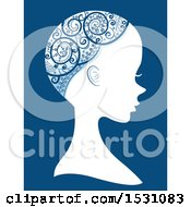Clipart Of A Silhouette Female Profile With An Ornate Design Over Her Bald Head On Blue Royalty Free Vector Illustration